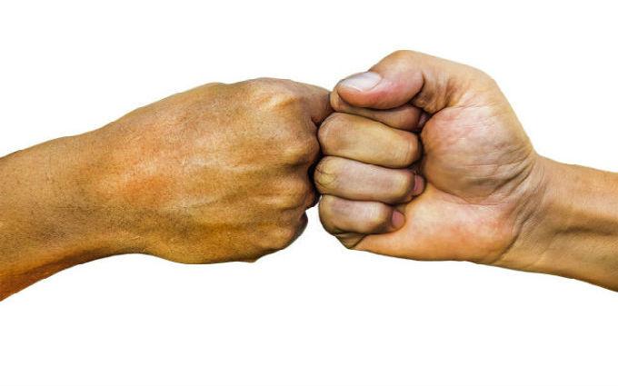 handen punch foto op management coaching pagina